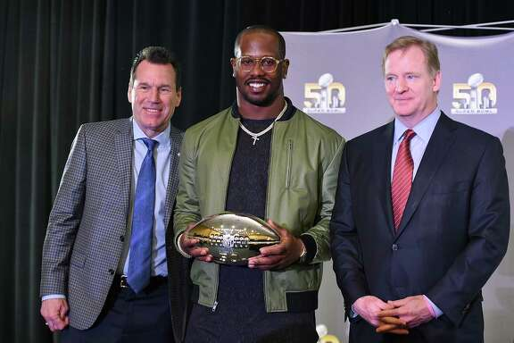 SAN FRANCISCO, CA - FEBRUARY 08:  Head coach Gary Kubiak of the Denver Broncos (L) and NFL commissioner Roger Goodell (R) poses with the Super Bowl 50 MVP Von Miller holding the trophy at the Moscone Center West on February 8, 2016 in San Francisco, California.
