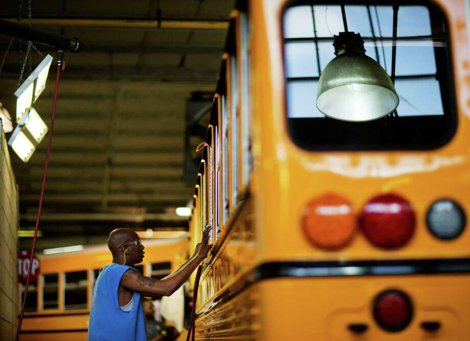 An employee works on a school bus on the assembly line at Blue Bird Corporation's manufacturing facility, in Fort Valley, Ga. The share of the working-age population that was either employed or looking for a job ticked up to 62.7 percent in January from 62.6 percent the month before. From a year earlier, some 1.31 million people have entered the labor force. Photo: David Goldman /Associated Press / AP