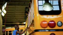 An employee works on a school bus on the assembly line at Blue Bird Corporation's manufacturing facility, in Fort Valley, Ga. The share of the working-age population that was either employed or looking for a job ticked up to 62.7 percent in January from 62.6 percent the month before. From a year earlier, some 1.31 million people have entered the labor force.