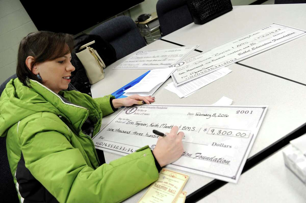 Heather Pontonio, president of the Bethel Education Foundation, along with other officials, visited three schools in Bethel Monday morning, Feb. 8, 2016, to deliver more than $30,000 in Grants.