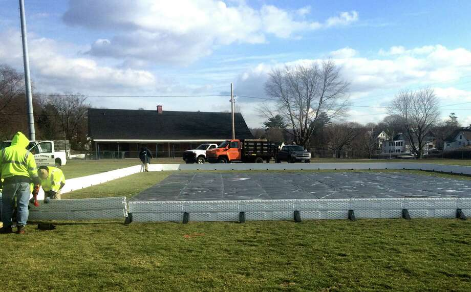 Ansonia Department of Public Works installs a 64 foot by 72 foot skating rink at Nolan Field in Ansonia, Conn. on Thursday, Jan. 14, 2016. . Photo: Michael P. Mayko / Hearst Connecticut Media / Connecticut Post