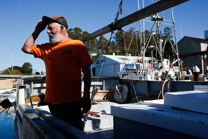 Fisherman Joe Tomasello talks about his boat which is docked at the harbor in Santa Cruz, Calif. on Monday, February 8, 2016. The Small Business Administration is offering small disaster loans to businesses affected by the delayed dungeness crab season.