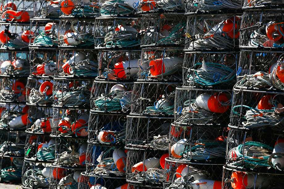 Crab fishing pots are stacked near the harbor in Santa Cruz, Calif. on Monday, February 8, 2016. The Small Business Administration is offering small disaster loans to businesses affected by the delayed dungeness crab season. Photo: James Tensuan, The Chronicle