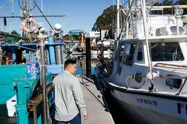 Vincent Pham walks to his boat in the harbor in Santa Cruz, Calif. on Monday, February 8, 2016. The Small Business Administration is offering small disaster loans to businesses affected by the delayed dungeness crab season.