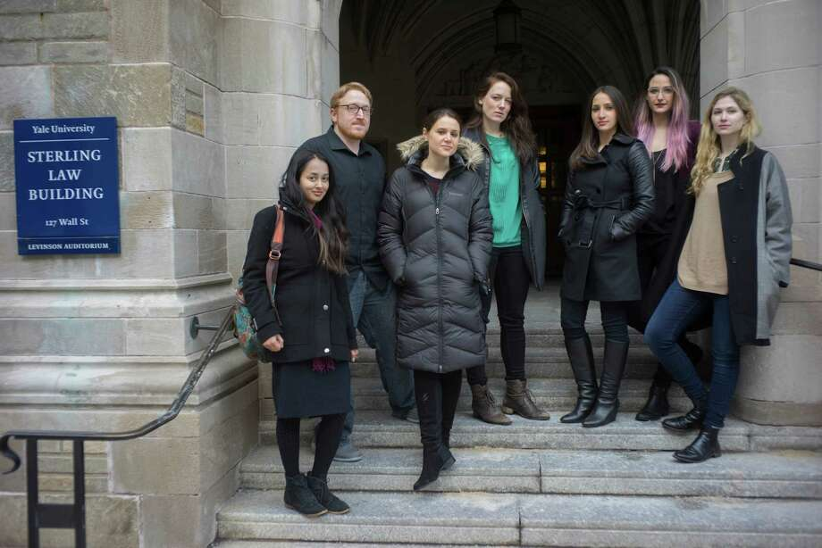 Yale Law students filed a lawsuit on Monday on Ebola quarantines that they say violate the U.S. Constitution and Connecticut state laws, on campus in New Haven. From left, Mekela Panditharatne, Kyle Fees, Elizabeth Deutsch, Kyle Edwards, Emma Roth, Paige Baum and Alexandra Brodsky. Photo: Douglas Healey / New York Times / Associated Press