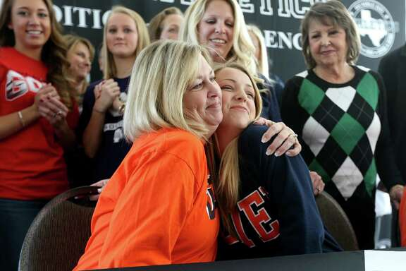 Kobi McNutt, of Kingwood Park High, shown with mother Rhonda McNutt, announces she will be playing soccer attending the University of Texas - El Paso at the Humble ISD signing day ceremony at the Humble Civic Center Wednesday, Feb. 3, 2016, in Humble, Texas. High school student athletes signed letters of intent to attend colleges and universities.