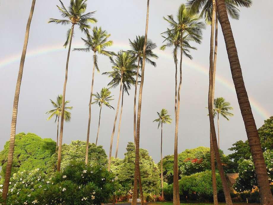A rainbow arcs over Waimea Plantation Cottages in Kauai. Photo: Waimea Plantation Cottages