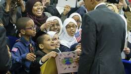 President Barack Obama stops to greets children from Al-Rahmah school and other guests during his visit to the Islamic Society of Baltimore, last week. Obama's visit to a U.S. mosque was timely and necessary.