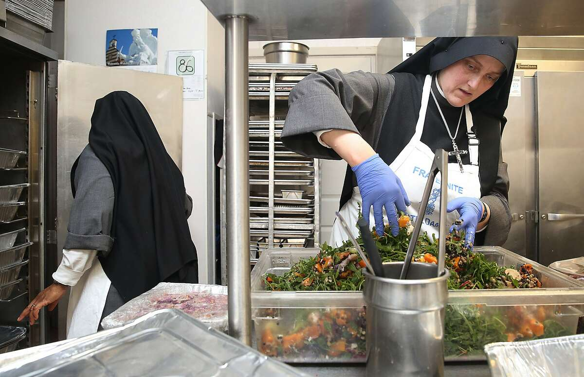 Sister Marie of the Angels (left) and Sister Marie Benedicte (right) of the Fraternite Notre Dame Mary of Nazareth Soup kitchen prepares food for lunch in San Francisco, California, on Monday, February 8, 2016. The landlord nearly doubled their rent and they are being evicted.