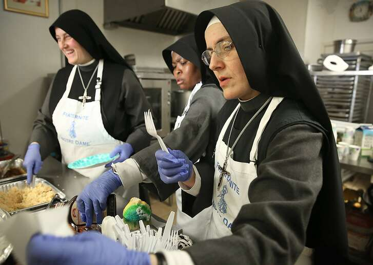 Sister Marie Benedicte l(eft), Sister Marie of the Angels (middle) and  Sister Marie Valerie (right) of the Fraternite Notre Dame Mary of Nazareth Soup serve lunch in San Francisco, California, on Monday,  February 8, 2016.  The landlord nearly doubled their rent and they are being evicted.