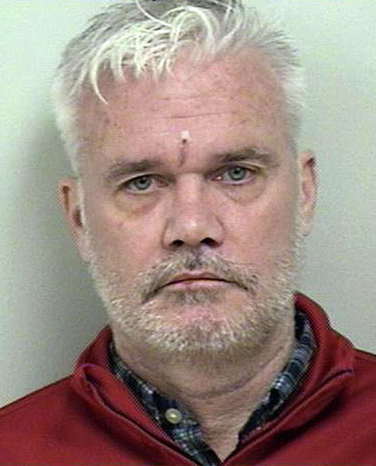 William Boland, 52, of Main Street, faces a series of charges after police said he struck the front of Senor Salsa restaurant last month and left the scene. Photo: Westport Police Department / Westport News