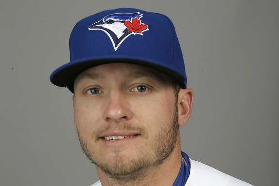 This is a 2015 photo of Josh Donaldson of the Toronto Blue Jays baseball team. This image reflects the Toronto Blue Jays active roster as of Saturday, Feb. 28, 2015, when this image was taken at spring training in Dunedin, Fla. Josh Donaldson has won the AL MVP, earning the honor after helping boost the Toronto Blue Jays back into the playoffs for the first time since 1993. The third baseman got 23 first-place votes from members of the Baseball Writers' Association of America in results announced Thursday, Nov. 19, 2015.