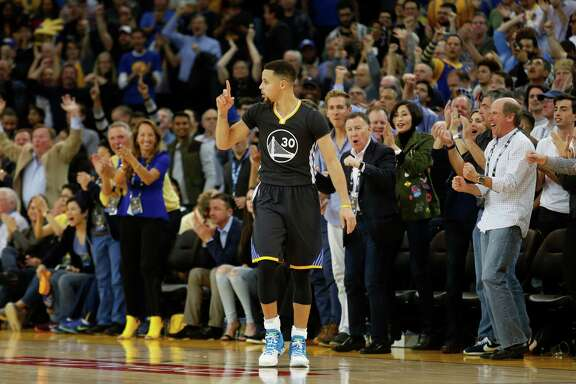 Golden State Warriors guard Stephen Curry celebrates during the fourth quarter of his basketball game against Oklahoma City Thunder on Saturday, February 6, 2016 in Oakland, Calif.