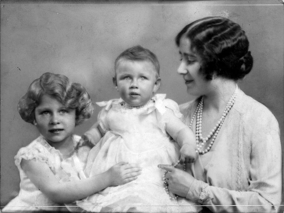 Queen Elizabeth, Queen Consort to King George VI with Princesses Elizabeth (left) and Margaret Rose (1930 - 2002), 1930.