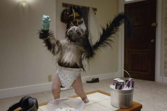"""This image provided by Mountain Dew shows a """"Puppymonkeybaby"""" in a scene from the company's Kickstart spot for Super Bowl 50. (PepsiCo via AP)"""