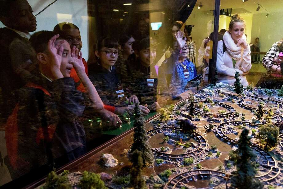 The Beaver Run exhibit at the Museum of Math in New York allows visitors to reconfigure sections of track in an attempt to get two beaver figurines to meet each other. Photo: CHRISTIAN HANSEN / New York Times / NYTNS