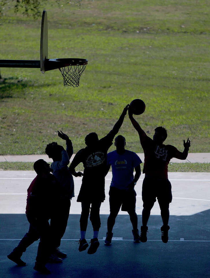 A group of guys play a game of basketball at Spotts Park, Thursday, Feb. 4, 2016, in Houston. (Cody Duty / Houston Chronicle)