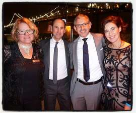 "Illuminate the Arts board members (from left) Harley Dubois, Rich Silverstein, Illuminate founder-CEO Ben Davis and his wife, Vanessa Inn, at Waterbar to celebrate the ""Bay Lights"" relighting kick-off for Super Bowl 50 celebrations in San Francisco. Jan 2016."