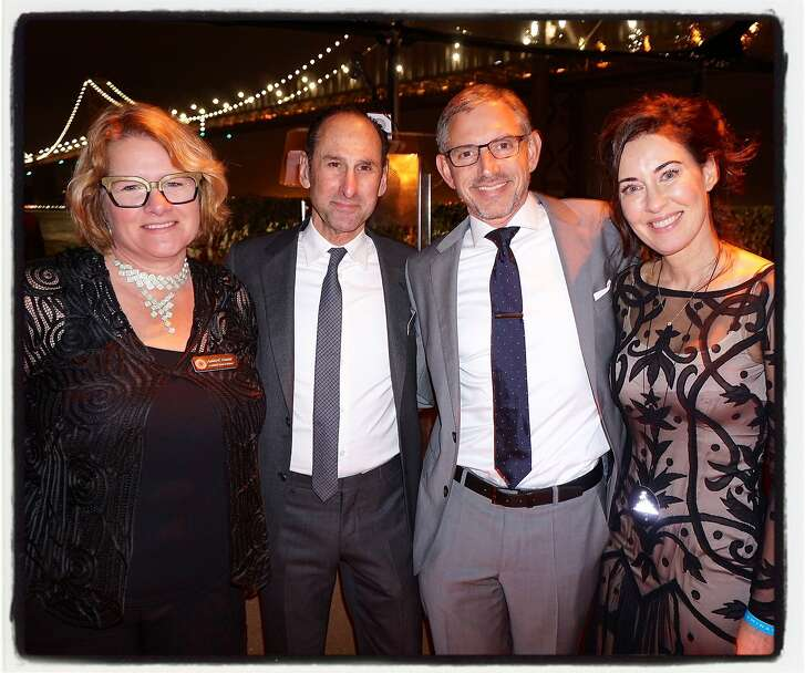 """Illuminate the Arts board members (from left) Harley Dubois, Rich Silverstein, Illuminate founder-CEO Ben Davis and his wife, Vanessa Inn, at Waterbar to celebrate the """"Bay Lights"""" relighting kick-off for Super Bowl 50 celebrations in San Francisco. Jan 2016."""