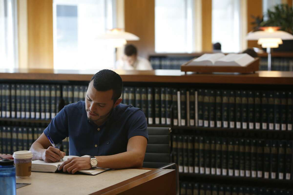 Paul Monge, first year UC Berkeley law student, works in the main reading room in Boalt Hall on Monday, February 8, 2016 in San Francisco, Calif.