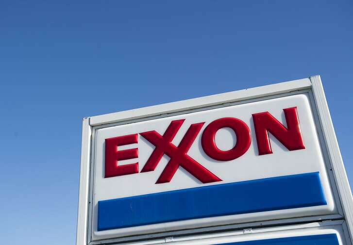 (FILES) This file photo taken on January 5, 2016 shows an Exxon gas station in Woodbridge, Virginia. ExxonMobil reported a 58 percent drop in fourth-quarter earnings as plunging oil prices dented results in the US oil giant's exploration and production business.