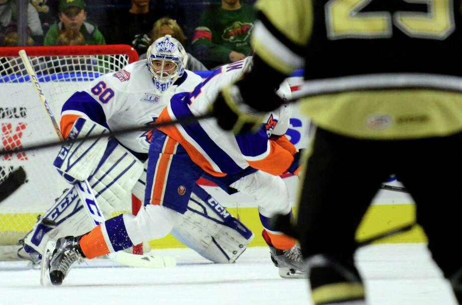 """Sound Tigers goalie Christopher said he doesn't like wearing the throat guard — the """"dangler,"""" he called it — below his mask. Photo: Christian Abraham / Hearst Connecticut Media / Connecticut Post"""