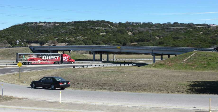 The state plans to spend about $6 million to lower the pavement around this Interstate 10 overpass at Harper Road (RR 783) in Kerr County where the low clearance of 15 feet , 5 inches eastbound forces tall vehicles to detour through Kerrville along Texas 27. Photo: Zeke MacCormack / San Antonio Express-News / San Antonio Express-News