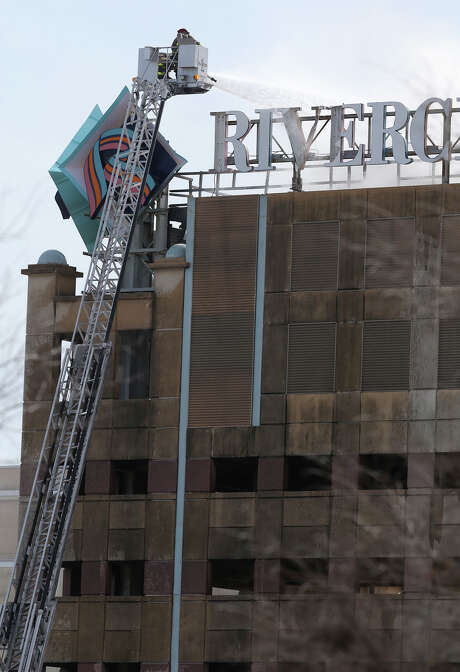 Smoke billows from a fire Monday at the Crockett Street garage at the Shops at Rivercenter. San Antonio Fire Department sent 22 units to put out the fire on the top floor of the garage, which there are cooling unit, but no vehicles. Photo: John Davenport /San Antonio Express-News