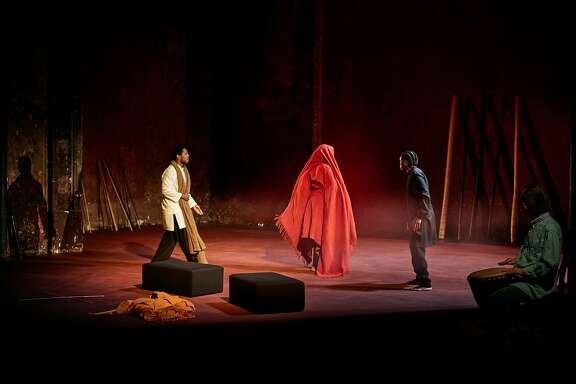 "Jared McNeill, left, Carole Karemera and Ery Nzaramba in Peter Brook and Marie-Helene Estienne's ""Battlefield"""