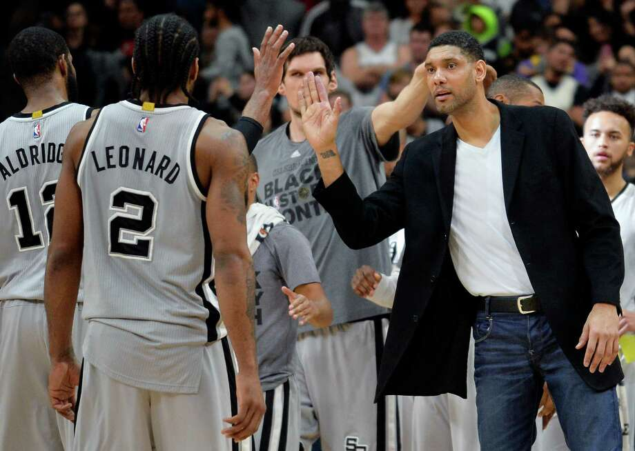 San Antonio Spurs forward Tim Duncan, right, congratulates Spurs forward Kawhi Leonard (2) on a successful play as he walks off of the court during a timeout in the second half of an NBA basketball game against the Los Angeles Lakers, Saturday, Feb. 6, 2016, in San Antonio. Photo: Darren Abate, FRE / Associated Press / FR115 AP