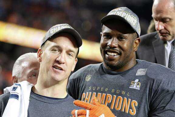 Denver Broncos' Von Miller (58) and QB Peyton Manning (18) are seen post-game after a win against the Carolina Panthers after the NFL Super Bowl 50 football game Sunday, Feb. 7, 2016, in Santa Clara, Calif.  (AP Photo/Gregory Payan)