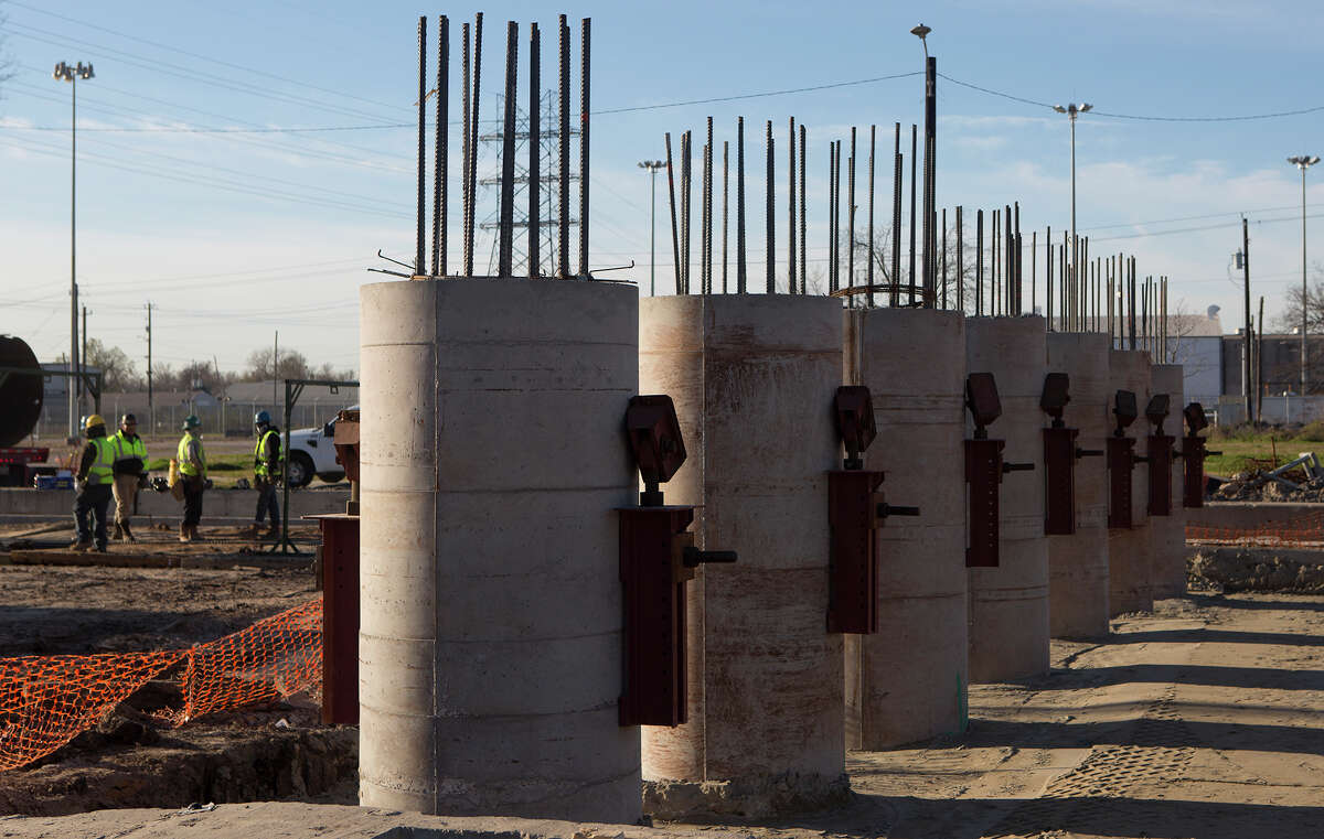Dozens of pillars have been set for the overpass along Harrisburg, which spans a freight railroad line.