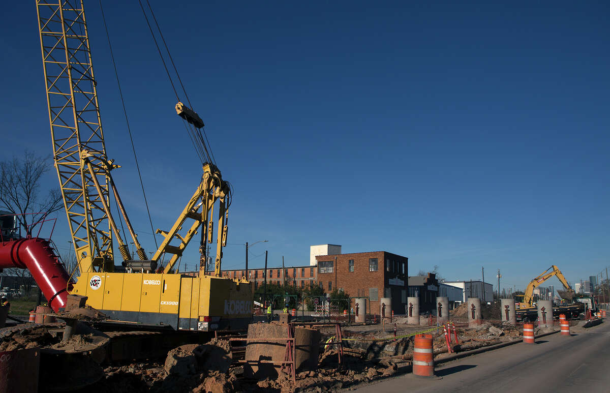 Heavy equipment prepares the area where a light rail and vehicle overpass is planend along Harrisburg on Feb. 8.