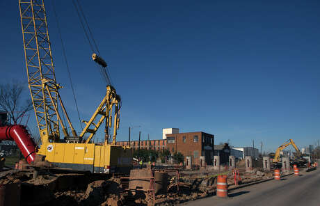 Heavy equipment prepares the area where a light rail and vehicle overpass is planend along Harrisburg on Feb. 8. Photo: Cody Duty, Houston Chronicle / © 2015 Houston Chronicle
