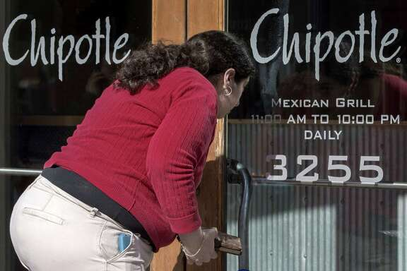 A potential customer looking to eat lunch Monday peers through the locked door of a Chipotle in the Georgetown area of Washington, D.C. The chain kept all its U.S. locations closed early Monday as its executives went over new food-safety procedures with employees. Chipotle restaurants across the US are temporarily closing until 3pm EST in an effort to educate 60,000 employees about the food-borne illnesses that have rocked the company in recent months. Food safety protocols will also be explained in the meeting.  / AFP / PAUL J. RICHARDSPAUL J. RICHARDS/AFP/Getty Images