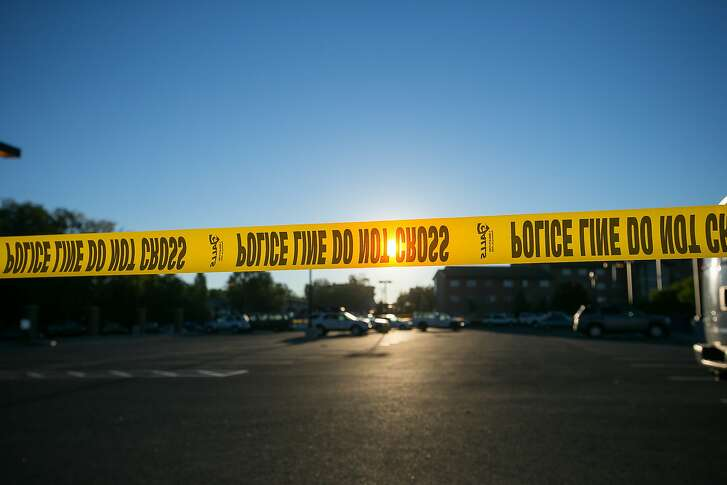 Police tape stretches across a section of street by Northern Arizona University campus in Flagstaff, Ariz., Friday, Oct. 9, 2015,  after an early morning fight between two groups of college students escalated into gunfire leaving one person dead and three others wounded, authorities said.  (Michael Schennum/The Arizona Republic via AP)  MARICOPA COUNTY OUT; MAGS OUT; NO SALES; MANDATORY CREDIT