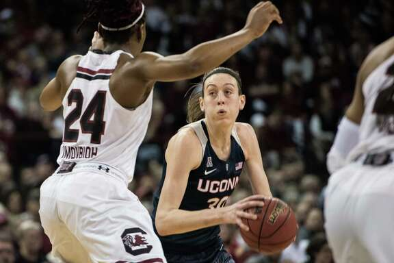 Connecticut forward Breanna Stewart (30) eyes the basket against South Carolina forward Sarah Imovbioh in the second half of Monday night's game at Columbia, S.C. Stewart had 25 points, 10 rebounds and five blocks as the top-ranked Huskies beat the No. 2 Gamecocks 66-54.