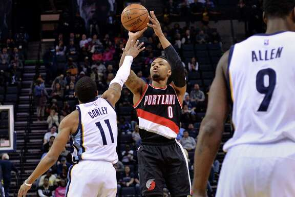 Blazers guard Damian Lillard, who had 33 points, puts up a jumper over Grizzlies guard Mike Conley.