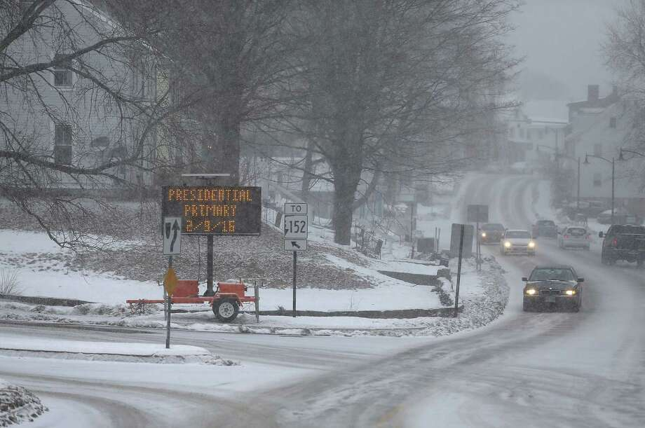 A sign in Newmarket, N.H., reminds voters that the primary is today. A storm that threatened to drop more than a foot of snow on southeastern Massachusetts moved into the area Monday. Photo: Joe Raedle /Getty Images / 2016 Getty Images