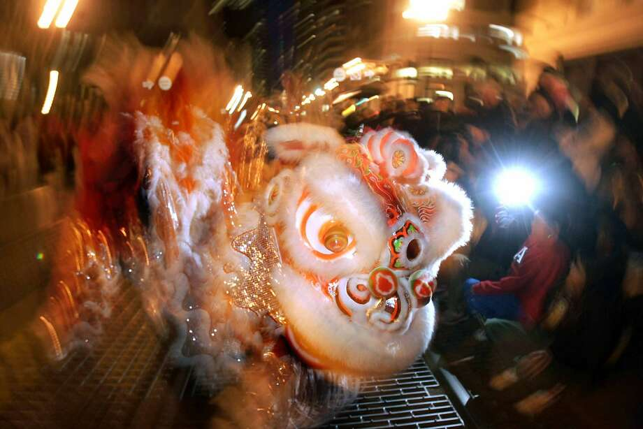 """A lion makes its way down Market St. The San Francisco Chinese New Year Parade celebrates  """"Year of the Pig"""" in this file photo from a past parade. Firecrackers, elaborate costumes, the newly crowned Miss Chinatown and the 201'  Golden Dragon will wind their way through the streets of downtown San Francisco once again on Feb. 11. Photo: Christina Koci Hernandez/CHRONIC, SFC"""