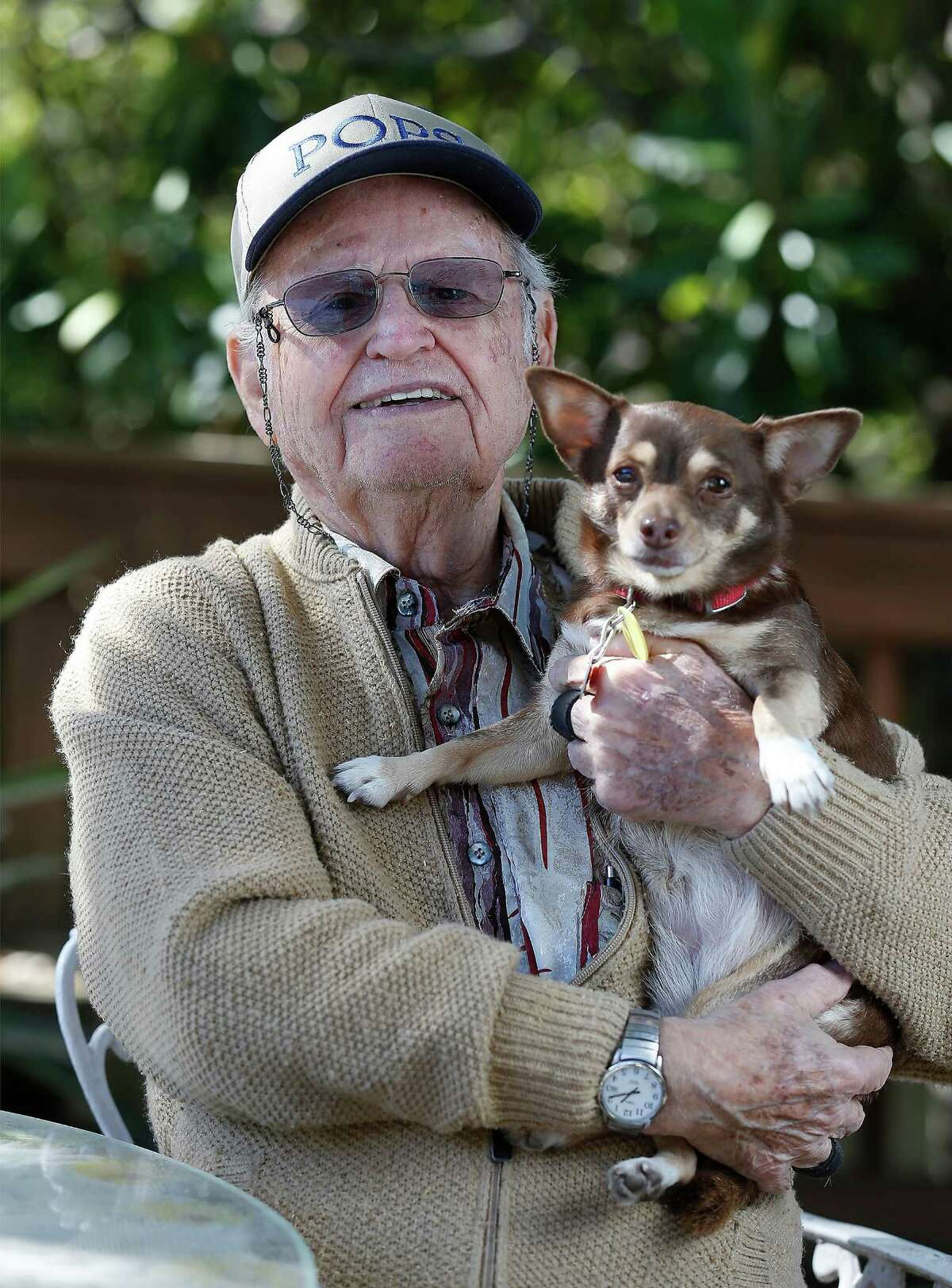 Six years ago, Edgar Fischel had his beloved female Chihuahua named Little Girl stolen out of his car when running an errand. But thanks to an embedded microchip on the Chihuahua, Fischel, 89, was reunited with his pet. Little Girl hardly ever leaves his side and shows affection toward Fischel at every opportunity. Fischel now enjoys the company of Little Girl and his other Chihuahua, Little Boy, which he adopted a year after Little Girl went missing. The retired educator loves the company of both his Chihuahuas. (Kin Man Hui/San Antonio Express-News)
