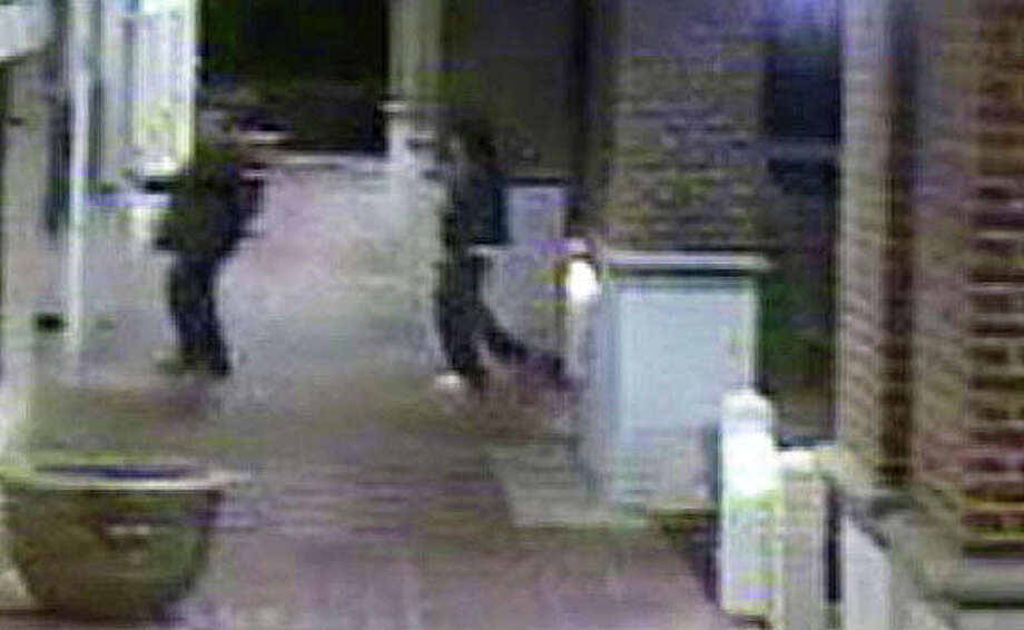 A video surveillance image shows a Lenox Jewelers employee, with an armed robbery suspect who had kidnapped him, entering Lenox Jewelers on Black Rock Turnpike as thieves stole millions in gems and other jewelry in April 2013. Five people have been arrested in the $3.1 million heist. Photo: File Photo / File Photo / Fairfield Citizen