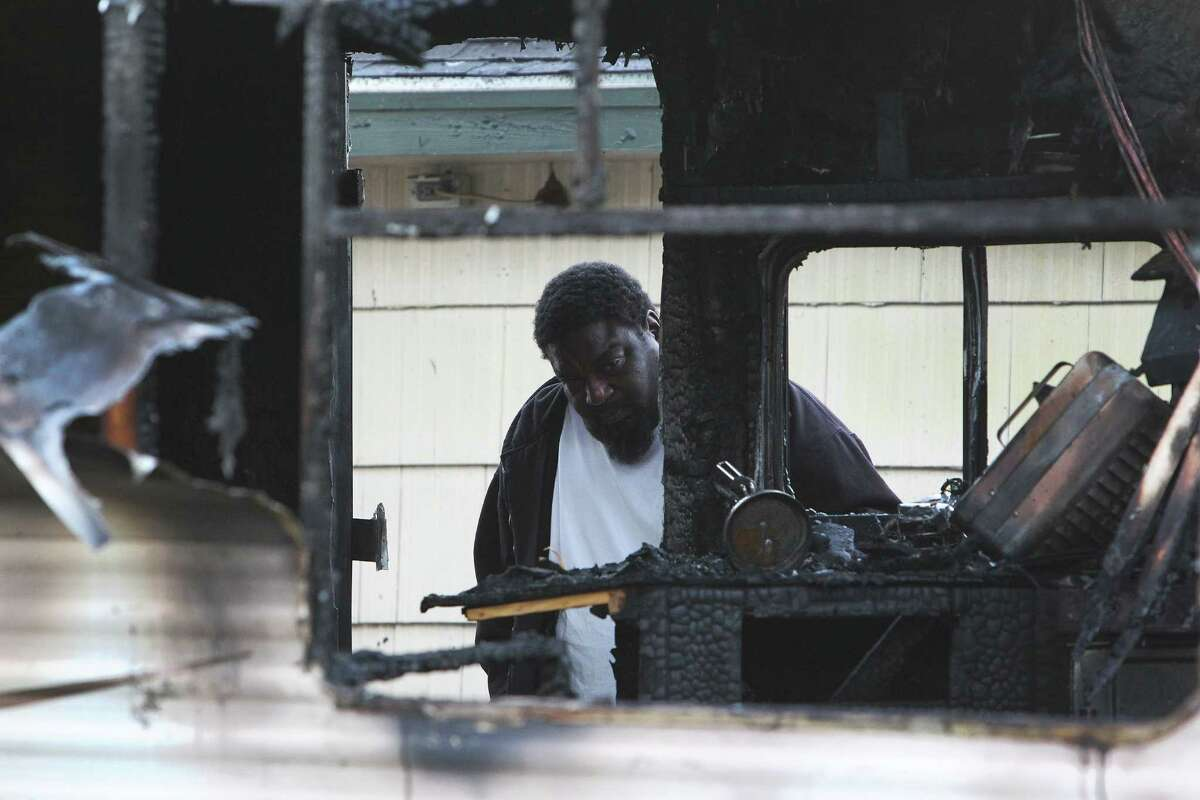 Lamar Williams the older brother of a man who died in a mobile home fire at 6046 Westover, reflects at the scene Tuesday, Feb. 9, 2016, in Houston.