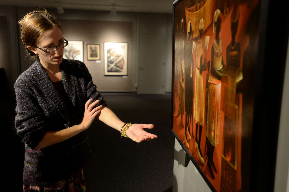 "Sarah Bellian, curator at the Museum of the Gulf Coast, talks about the painting ""Let The Circle Be Unbroken,"" a painting by artist Harvey Johnson on display at the museum. Bellian is looking to expand the museum's collection on Port Arthur's west side neighborhood. 