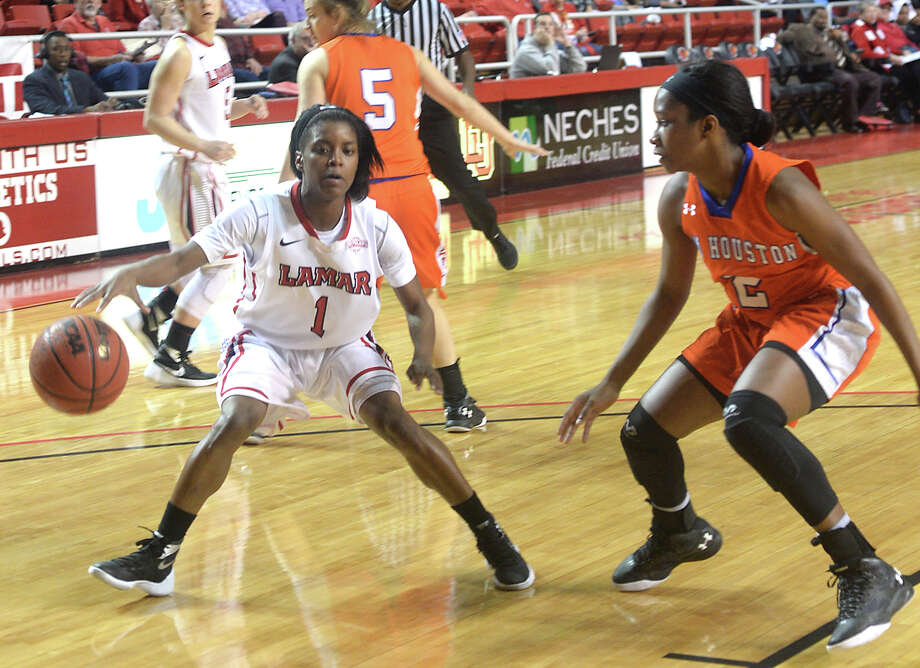 Lamar's Addesha Collins is pressed by Sam Houston State's Kamry Orr as she looks to move the ball inside during Wednesday night's match-up at the Montagne Center. Photo taken Wednesday, January 27, 2016 Kim Brent/The Enterprise Photo: Kim Brent / Beaumont Enterprise