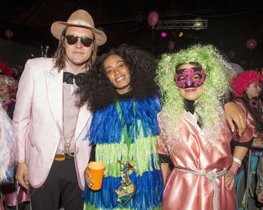 Win Butlerof the band Arcade Fire, Solange Knowles and Régine Chassagne of Arcade Fire gather for a photo at the Krewe of Muses pre-parade party on Feb. 4, 2016 in New Orleans. Photo: Erika Goldring/Getty Images