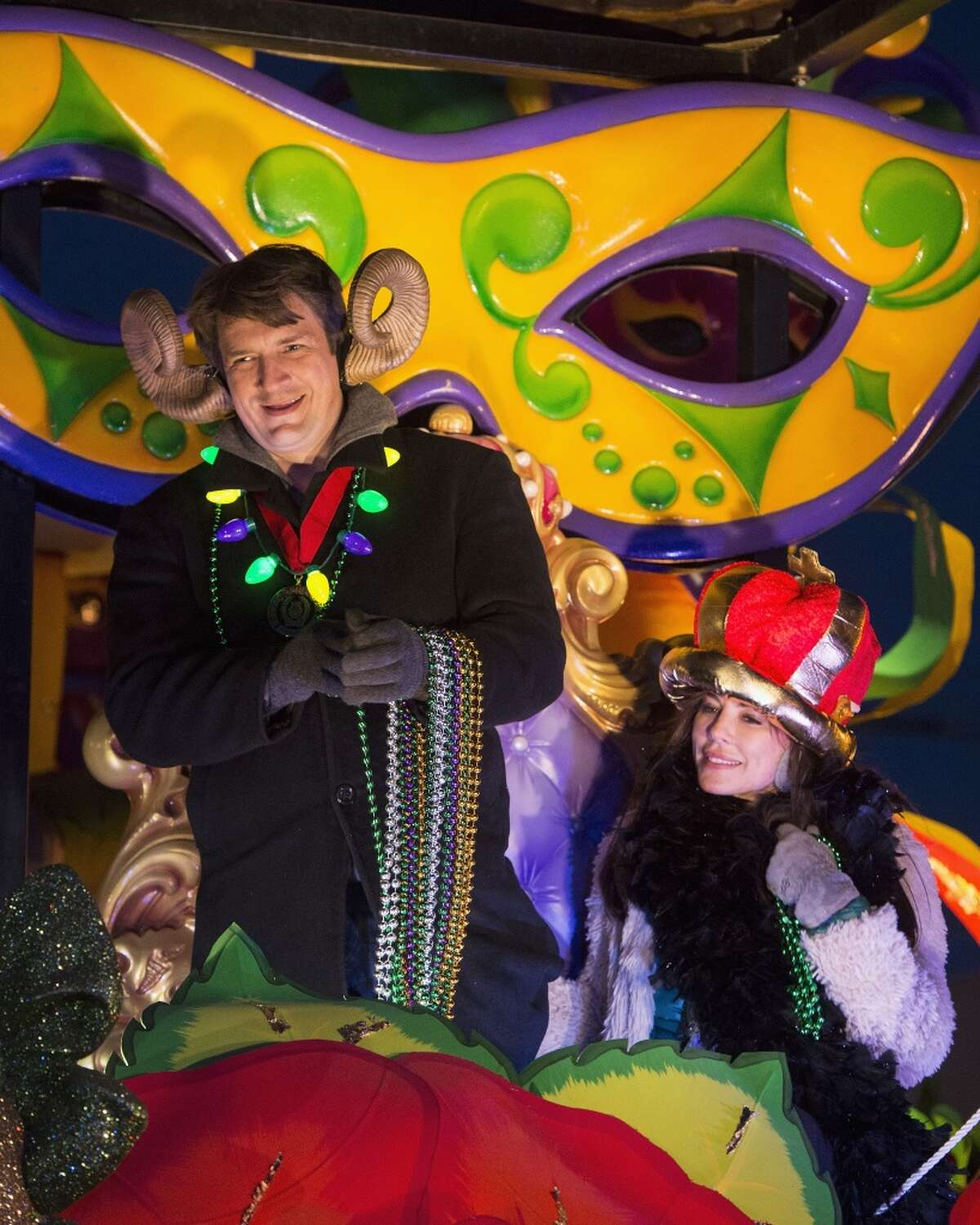 Actors Nathan Fillion and Krista Allen ride in the Krewe of Orpheus parade on Feb. 8, 2016 in New Orleans.