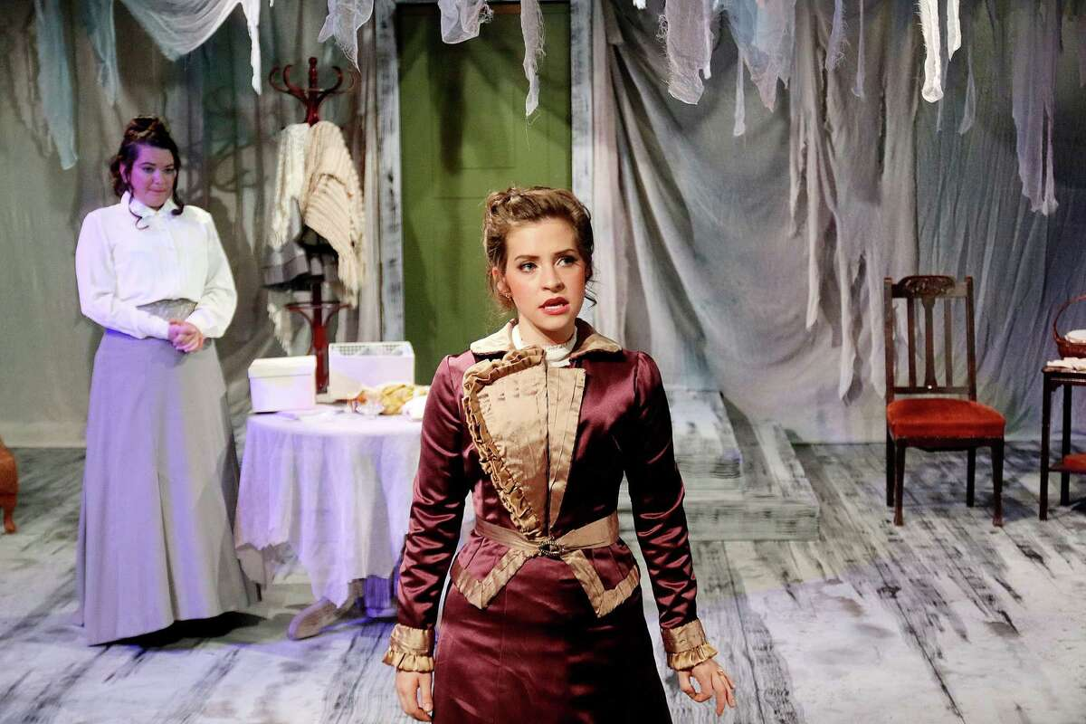 """Shanae'a Moore, center, stars as Nora and Erin Kidwell, behind, stars as her friend Christine in """"A Doll's House"""" at Classical Theatre Company."""