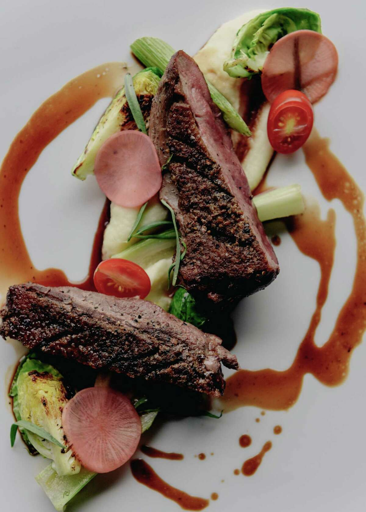 Seared Moscovy duck breast, parsnips, seasonal vegetables and demi-glace at the Durham House, 1200 Durham. The restaurant has a new executive chef, Mike McElroy, who has updated the menu.