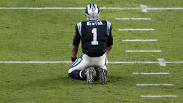 Carolina Panthers quarterback Cam Newton kneels on the field after fumbling in the fourth quarter against the Denver Broncos in Super Bowl 50 at Levi's Stadium in Santa Clara, Calif. Newton was sacked six times and fumbled twice.